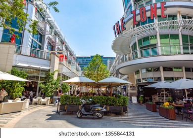 Johannesburg, South Africa - March 6  2019:  Rosebank  shopping mall with tourists in day light.