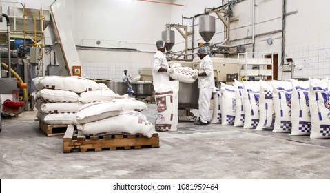 Johannesburg, South Africa, March 9 - 2015: Industrial bread making factory with large bags of flour being loading into mixers.