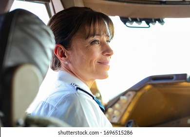 Johannesburg, South Africa - May 08 2012: British Airways Middle Aged Female Captain Pilot in an Airplane cockpit