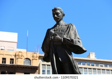 Johannesburg, South Africa - May 2018 : Statue of M. K. Gandhi as a young attorney at law on Gandhi Square in the business district