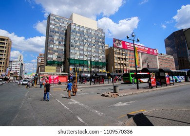 Johannesburg, South Africa - May 2018 : Bus stops on Gandhi Square with the facade of the Gandhi Mall