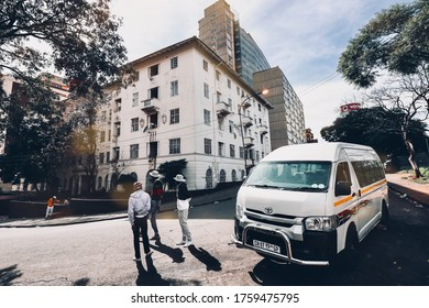 Johannesburg, South Africa - May 28 2020: street corner in Hillbrow with a taxi parked