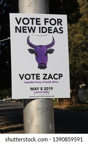 Johannesburg, South Africa. May 7th 2019. Political campaign poster for the South African Capitalist Party also known as The Purple Cow. A contender in the May 8th general election.