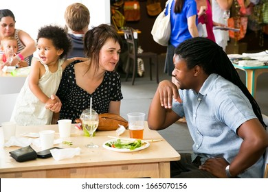 Johannesburg, South Africa - November 10 2013: A young diverse family enjoying a day out at a Food and Wine Fair drinking and generally enjoying a day out at a Food and Wine Fair