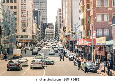 JOHANNESBURG, SOUTH AFRICA - NOVEMBER 13, 2014: rush hour and traffic jam on Von Wiellig Street at the crossroad with Commissioner St in the crowded and modern multiracial metropolis of South Africa.