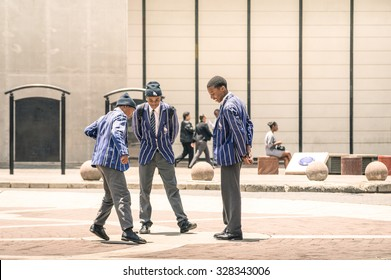 JOHANNESBURG, SOUTH AFRICA - NOVEMBER 13, 2014: young students at Gandhi square. After renovation finished in 2002, the area got a renovated bus terminal , 24-hour security.