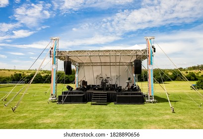 Johannesburg, South Africa - November 25, 2012: Small outdoor concert venue stage and lighting in a empty field