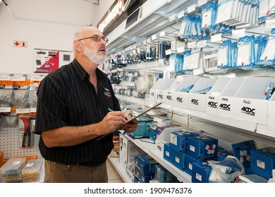 Johannesburg, South Africa - November 27, 2012: Store manager doing inventory inside of a DIY electrical wholesale retail shop