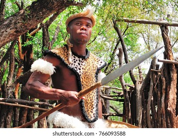 JOHANNESBURG, SOUTH AFRICA - OCT.23, 2012: A  Zulu Warrior greets vistors to Lesedi Cultural Village. The Zulus are one of four South African tribes that are featured in the educational experience.