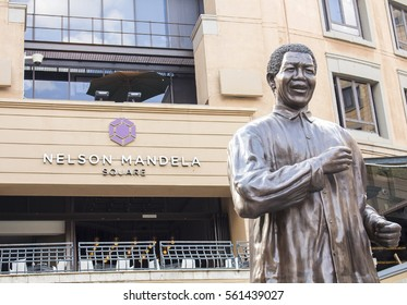 Johannesburg, South Africa -  October 31, 2016: The bronze monument Nelson Mandela on the Nelson Mandela Square, Sandton, Johannesburg. The public place. Shopping area.