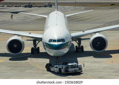 JOHANNESBURG, SOUTH AFRICA - October 8 2018: A Cathay Pacific Boeing 777 jumbo jet at gate at the O.R. Tambo International Airport, Johannesburg . Editorial Use Only.