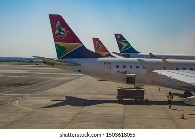 JOHANNESBURG, SOUTH AFRICA - October 8 2018: Tail Wings of SA Airlink and South African Airways jumbo jets at the O.R. Tambo International Airport, Johannesburg . Editorial Use Only.