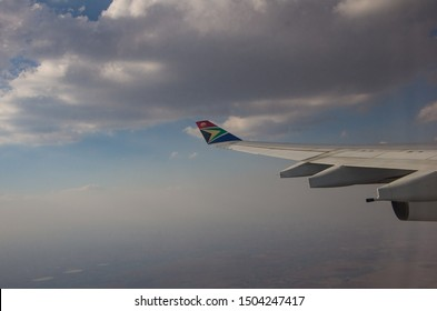 JOHANNESBURG, SOUTH AFRICA - October 8 2018: The wing of South African Airways jumbo jet on the air with clear sky above Johannesburg, South Africa. Editorial Use Only.