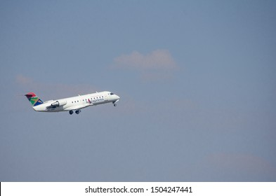 JOHANNESBURG, SOUTH AFRICA - October 8 2018: A South African Express Bombardier jet takes off on the sky from the O.R. Tambo International Airport, Johannesburg . Editorial Use Only.