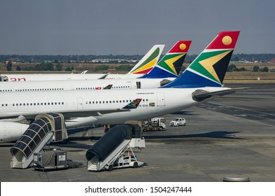 JOHANNESBURG, SOUTH AFRICA - October 8 2018: Tail Wings of South African Airways and Ethiopian Airways jumbo jets at the O.R. Tambo International Airport, Johannesburg . Editorial Use Only.