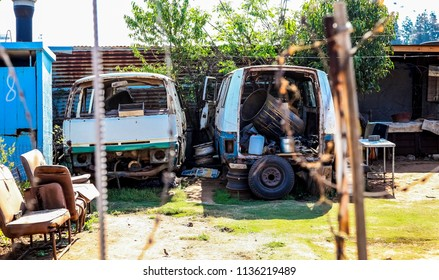 Johannesburg, South Africa, September 11, 2011, Scrapped Mini Bus Taxi in garden of Soweto Home