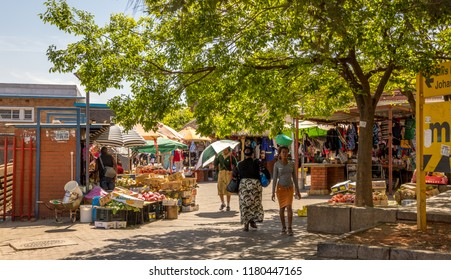 Johannesburg, South Africa - September 15, 2018: unidentified residents go about their daily lives in the historic suburb of Jeppestown in the Maboneng Precinct in the city