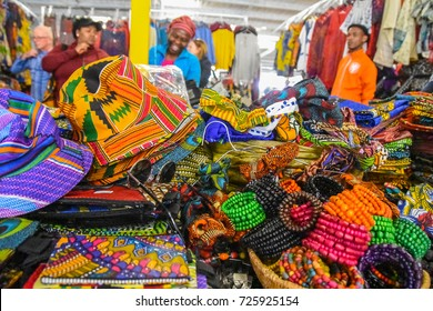 Johannesburg , South Africa - September 21 , 2017 : african colorful designs,hats,bags etc on a table at a market