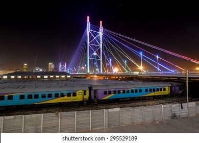 Johannesburg, South Africa - September 3, 2012: Nelson Mandela Bridge at night. The 284 meter long Nelson Mandela Bridge, which crosses over the 40 railway lines that lie spread beneath its span.
