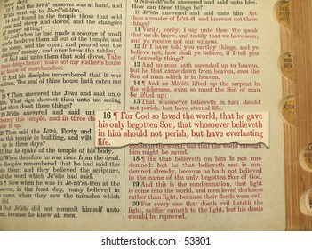 John 3:16 in close up imposed upon page in Bible