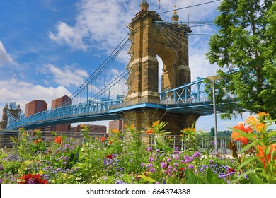 The John A. Roebling Bridge was built in 1866 to connect Covington, Kentucky to Cincinnati, Ohio.  It spans the Ohio River. - Shutterstock ID 664374388