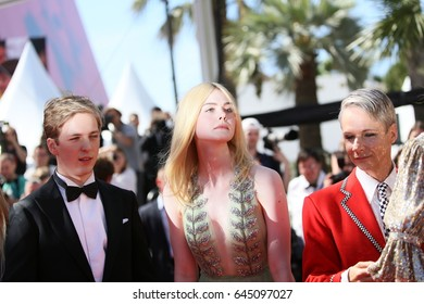 John Cameron Mitchell, Elle Fanning attend the 'How To Talk To Girls At Parties' screening during the 70th Cannes Festival at Palais des Festivals on May 21, 2017 in Cannes, France.