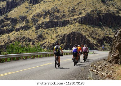 JOHN DAY, OREGON - JUN 23, 2018 - Bicyclists ride through Picture Gorge near John Day in eastern Oregon