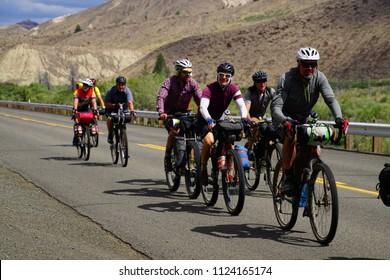 JOHN DAY, OREGON - JUN 23, 2018 - Bicyclists ride through Picture Gorge near John Day in eastern Oregon