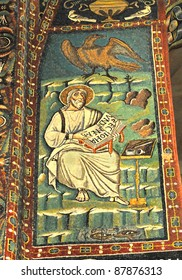 John the evangelist together with his symbol the eagle. Magnificent byzantine mosaic from the UNESCO listed basilica of St Vitalis, in Ravenna, Italy