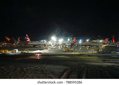 JOHN F. KENNEDY AIRPORT, NEW YORK -5 JAN 2018- Night view of the operations mess and delays at the John F. Kennedy International Airport (JFK) after the bomb cyclone winter snow storm Grayson.