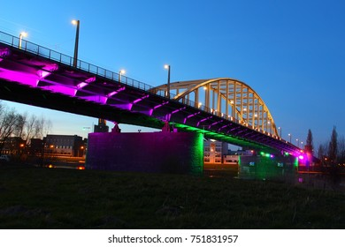 John Frost Bridge in Arnhem during blue hour while colorful lights shine on the bridge