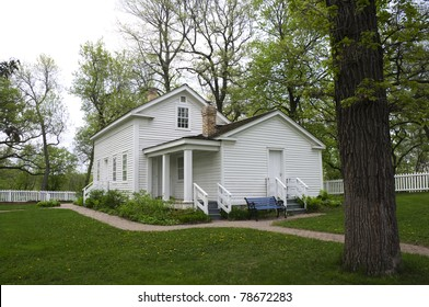 John H Stevens House and yard surrounded by white picket fence and trees in Minnehaha Park of Minneapolis Minnesota