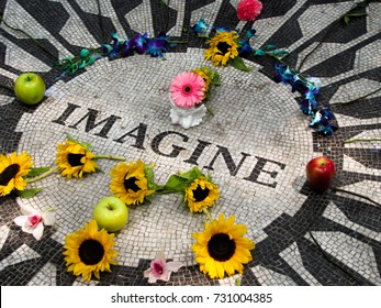 John Lennon Imagine mosaic in Central Park New York with tribute and memorial offerings from fans