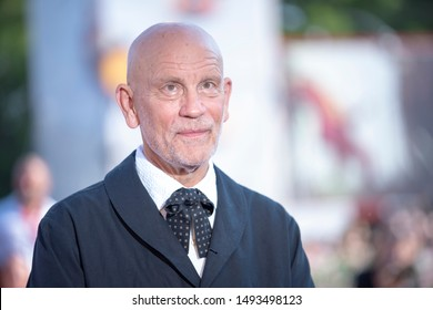 """John Malkovich walks the red carpet ahead of """"The New Pope"""" screening during the 76th Venice Film Festival at Sala Grande on September 01, 2019 in Venice, Italy."""