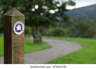 John Muir way trail sign post in Balloch park Scotland UK