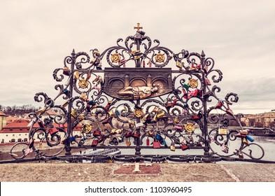 John Nepomuk and symbolic many locks of love, Charles bridge, Prague, Czech republic. Travel destination. Red photo filter.
