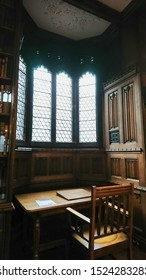 John Rylands Library, Manchester, United Kingdom - January 19, 2018: available study space with wooden table, chair and window in neo gothic style in the campus of University of Manchester
