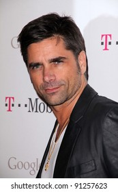 John Stamos at Google And T-Mobile Celebrate The Launch Of Google Music, Mr. Brainwash Studios, Los Angeles, CA 11-16-11