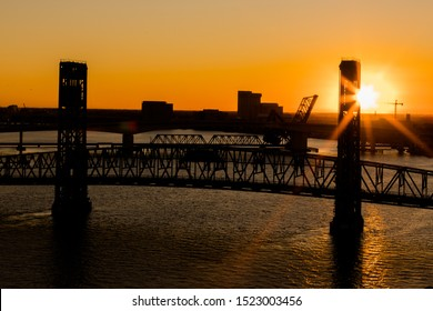 The John T. Alsop, Jr. Bridge in Jacksonville FL at a beautiful golden sunset. The bridge was previously named the Main Street Bridge and is still called that today.