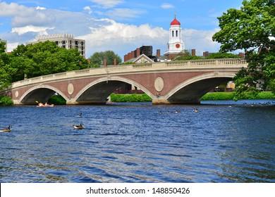 John W. Weeks Bridge over Charles River and clock tower in Harvard University campus in Boston, MA, USA