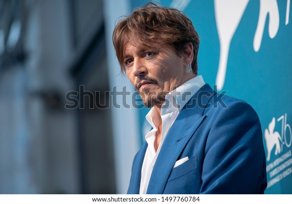 Johnny Depp attends a photocall for the film ''Waiting for the Barbarians'' presented in competition on September 6, 2019 during the 76th Venice Film Festival at Venice Lido.