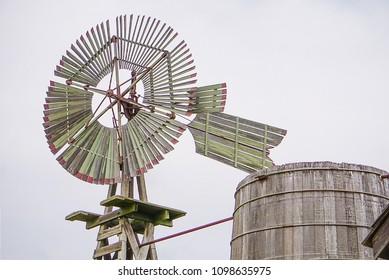 JOHNSON CITY, TEXAS - APRIL 3, 2018 - The Windmill and Rain Barrel at the Johnson Settlement at LBJ National Historical Park