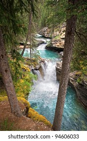 Johnston Canyon, Approximately 15 miles West of Banff, Banff National Park, Alberta, Canada. There are a series of Water Falls that range from 1.1 km (lower falls), to 2.7 km to the Upper Water Fall.