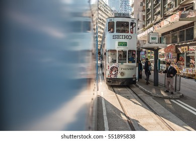 "JOHNSTON ROAD, HONG KONG - DECEMBER 10, 2016: Hong Kong Tramways is a public transport in metropolis. Known as ""Hong Kong Ding Ding"" with classic and unique style of double-deck tram."