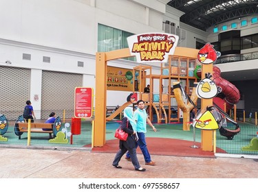 JOHOR BAHRU, MALAYSIA - AUGUST 17, 2017: A couple walking in front of ANGRY BIRDS ACTIVITY PARK at KOTARAYA COMPLEX. KOTARAYA COMPLEX is the famous shopping complex in JOHOR BAHRU.
