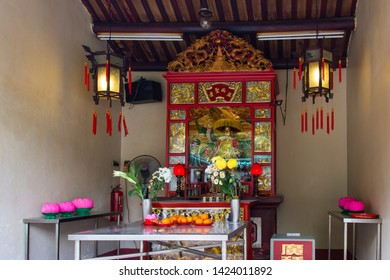 Johor Bahru, Johor, Malaysia - Feb 28th, 2015 - Statue and offerings inside  the Old Chinese Temple Of Johor Bahru.