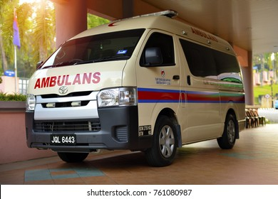 JOHOR BAHRU, MALAYSIA - OCTOBER 22, 2017: A medical ambulance standing by and parking infront of the hospital in Johor Bahru, Johor, Malaysia.