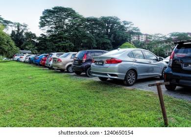 JOHOR BAHRU, JOHOR, MALAYSIA - SEPTEMBER 30, 2018: Day view of open air carpark in Johor Bahru City, Johor, Malaysia.
