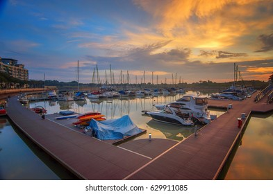 JOHOR, MALAYSIA: 28 APRIL 2017 -  Sunrise view of Puteri Harbour, Johor Bahru, Malaysia.This image may contain noise ,blurry clouds due to long exposure, soft focus and poor lighting