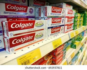 JOHOR, MALAYSIA - AUGUST 09 2017 : Row of Colgates toothpaste display on the shelf in the supermarket. Colgate is one of the established brand.
